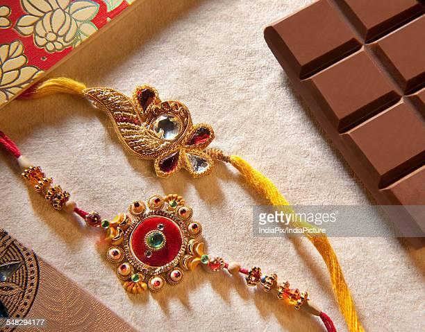 close-up of rakhis - raksha bandhan stock photos and pictures