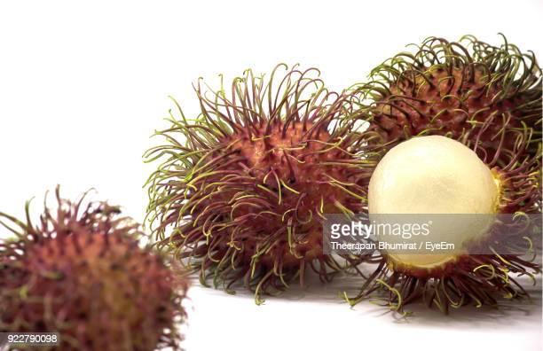 Close-Up Of Rambutans Over White Background