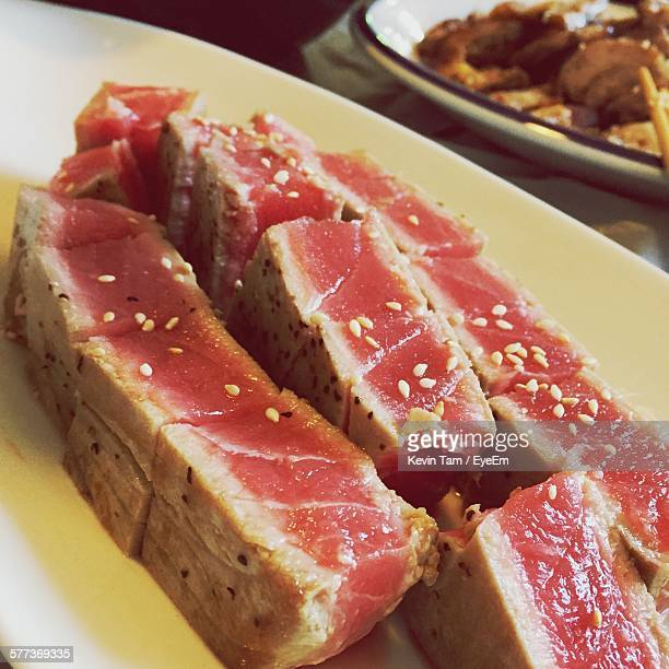 close-up of rare tuna served in plate on table - eyeem kevin tam stock pictures, royalty-free photos & images