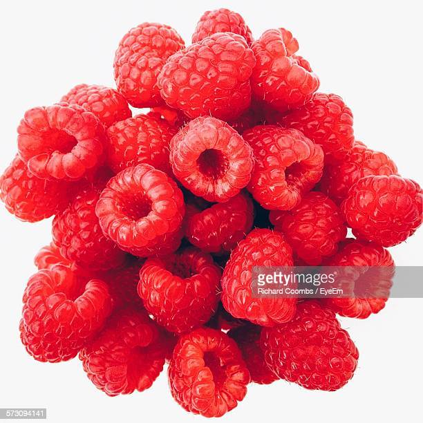 Close-Up Of Raspberries Against White Background