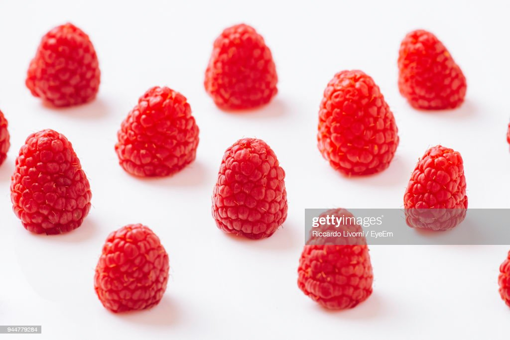 Close-Up Of Raspberries Against White Background : Stock Photo
