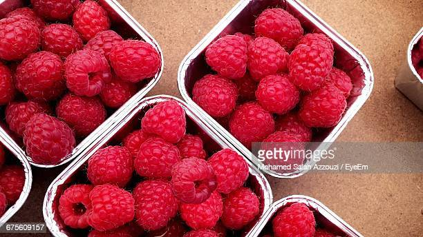 close-up of raspberries in containers - salah stock photos and pictures