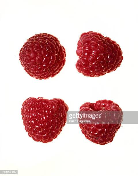 Close-up of raspberries on white