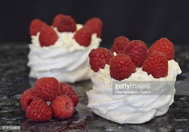 Close-Up Of Raspberry Fruits And Meringue On Table