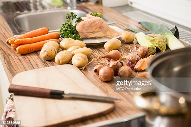 close-up of raw food on kitchen counter for chicken soup, munich, bavaria, germany - chicken soup stock photos and pictures