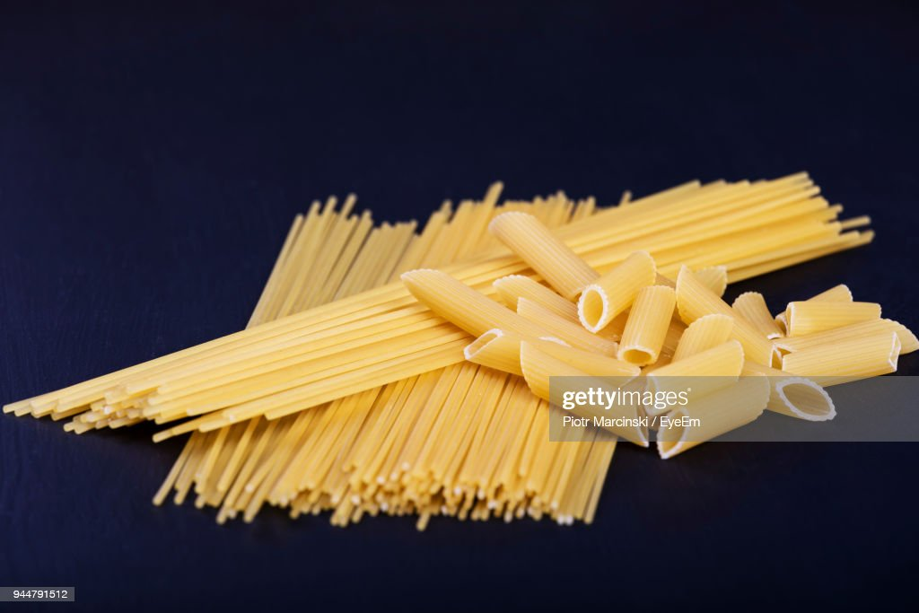 Close-Up Of Raw Pasta On Table : Stock Photo