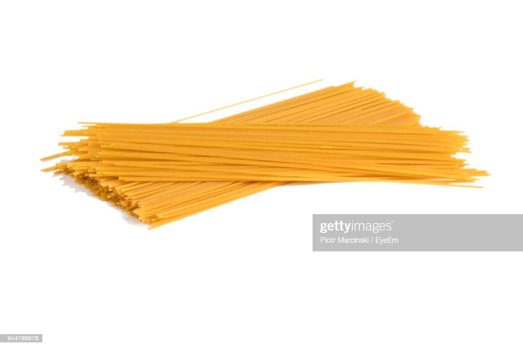 Close-Up Of Raw Pasta Over White Background : Stock Photo