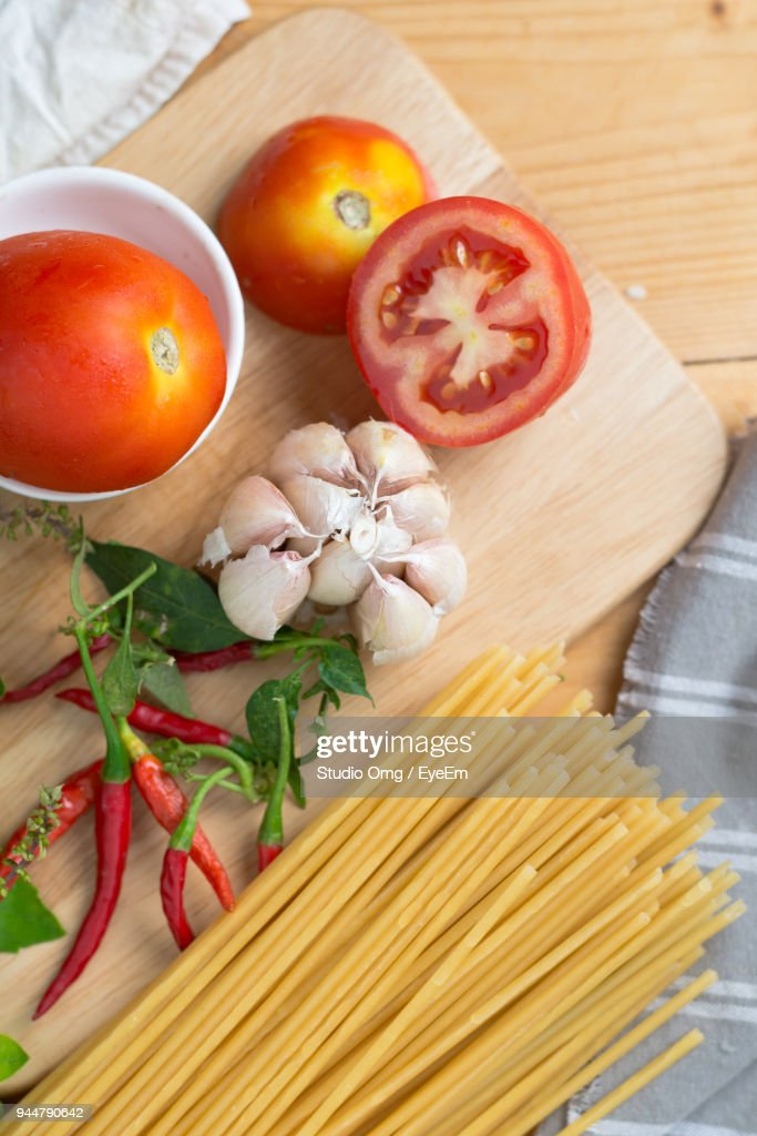 Close-Up Of Raw Pasta With Ingredients On Table : Stock Photo