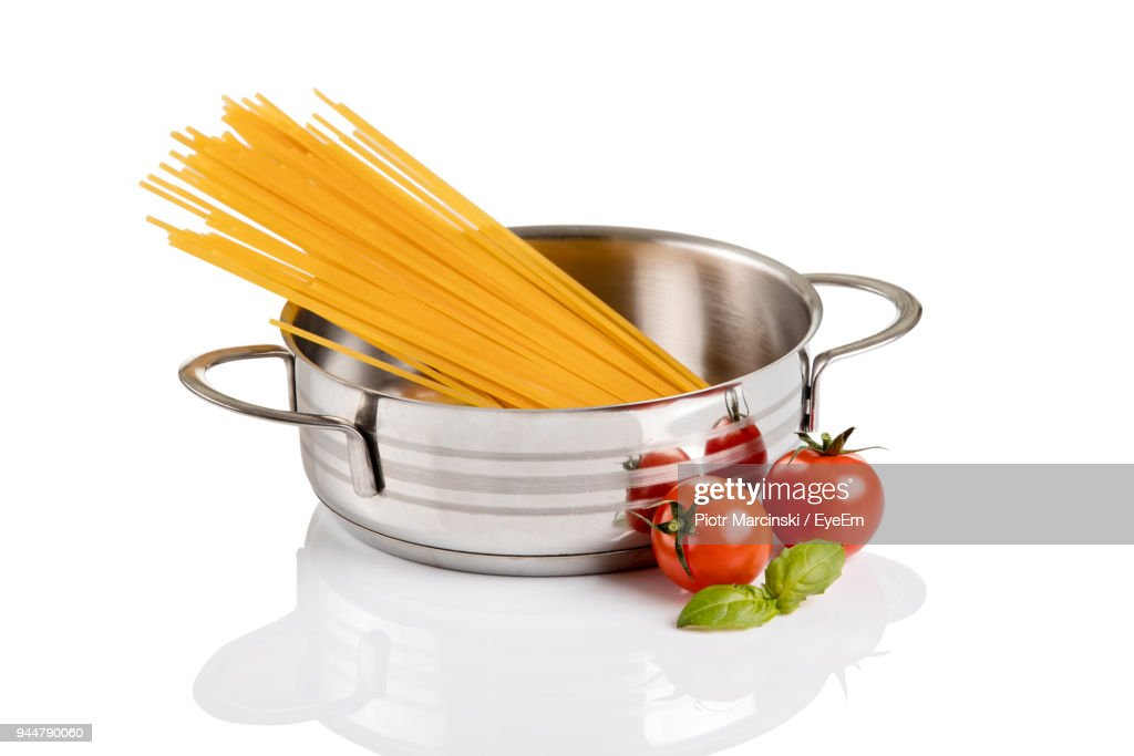 Close-Up Of Raw Pasta With Ingredients Over White Background : Stock Photo