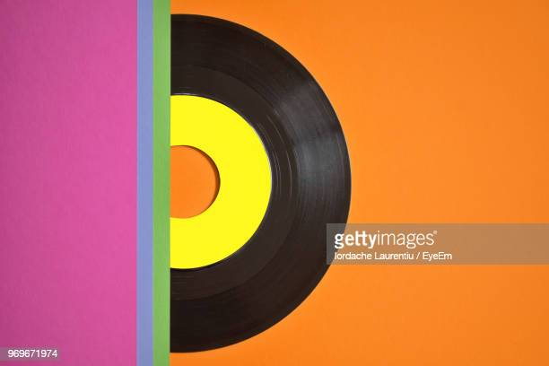 Close-Up Of Record On Orange Table