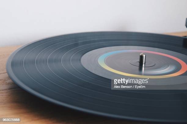 Close-Up Of Record On Table Against Wall