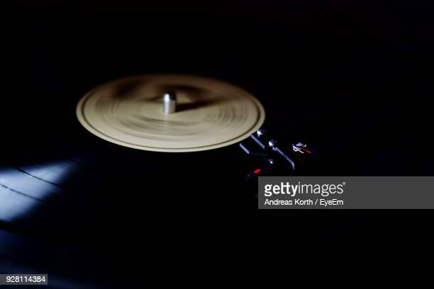 Close-Up Of Record Player Needle Against Black Background