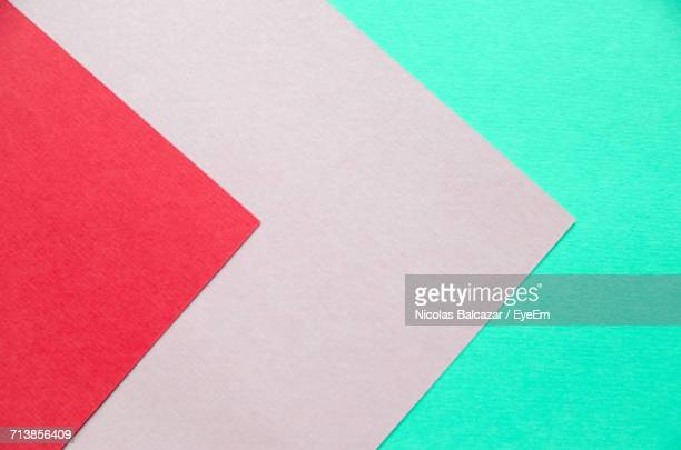 Close-Up Of Red And Pink Papers