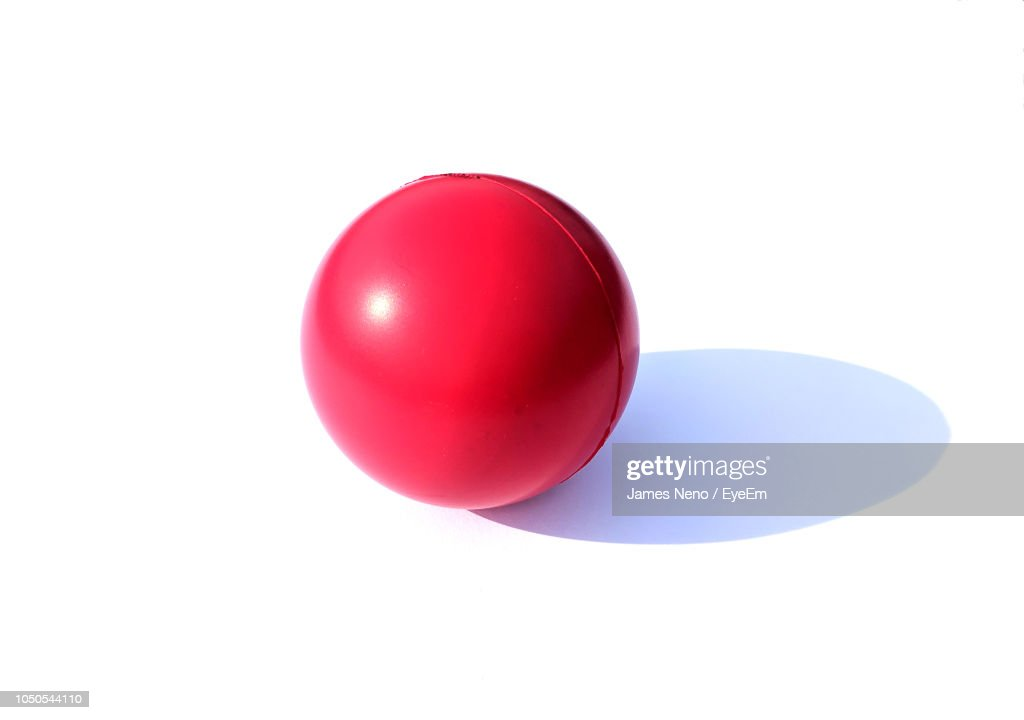 Close-Up Of Red Ball Against White Background : Foto stock