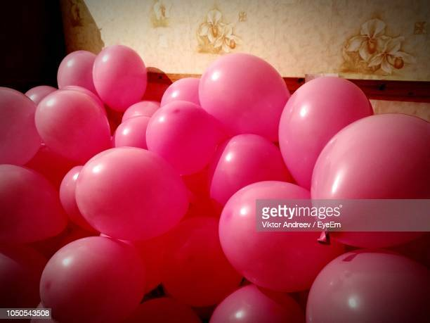 Close-Up Of Red Balloons Against Wall