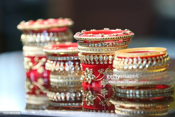close-up of red bangles on table - bangle stock pictures, royalty-free photos & images