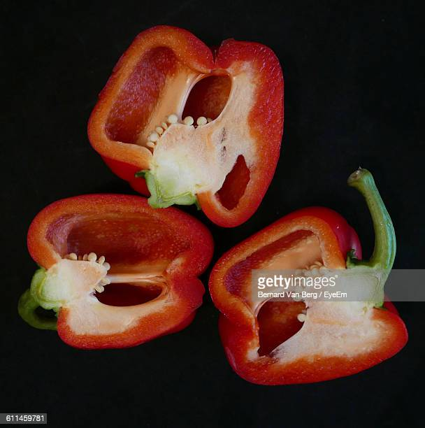 Close-Up Of Red Bell Pepper On Black Background