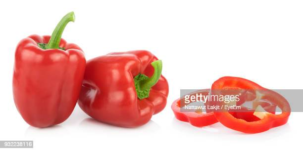 Close-Up Of Red Bell Peppers Over White Background
