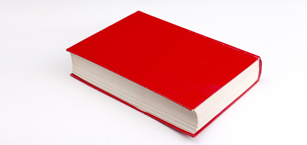 Close-Up Of Red Book Over White Background - gettyimageskorea