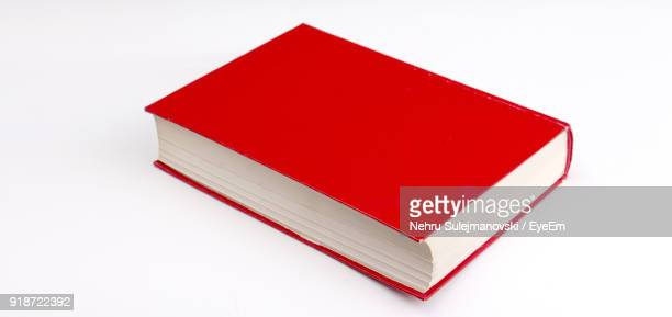 close-up of red book over white background - book imagens e fotografias de stock