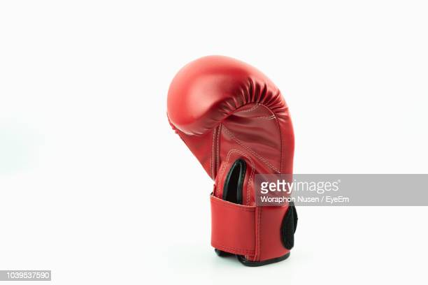 close-up of red boxing glove against white background - boxing gloves stock pictures, royalty-free photos & images