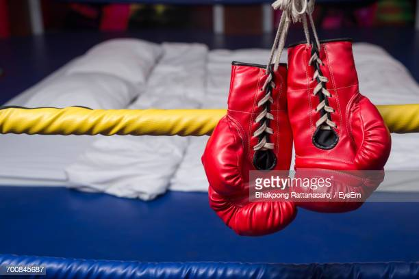 Close-Up Of Red Boxing Gloves Hanging