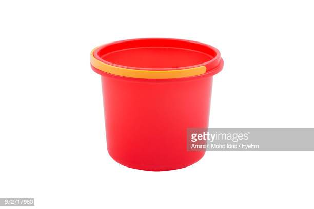 close-up of red bucket against white background - bucket stock pictures, royalty-free photos & images
