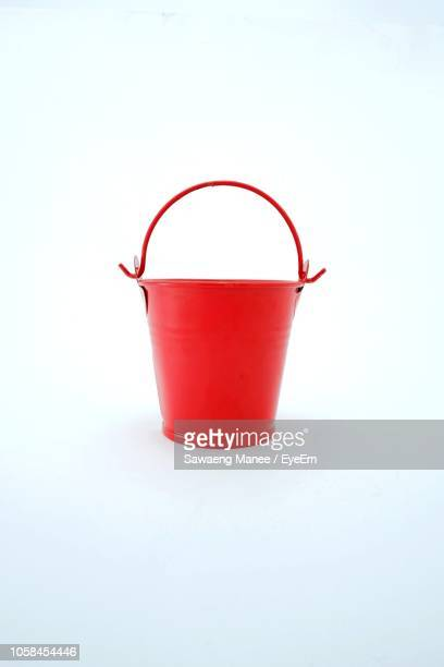close-up of red bucket on white background - バケツ ストックフォトと画像