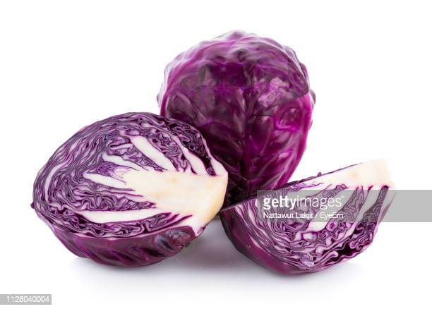 close-up of red cabbages over white background - rodekool stockfoto's en -beelden