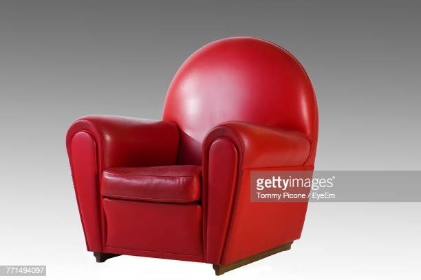 close-up of red chair against white background - lounge chair stock pictures, royalty-free photos & images