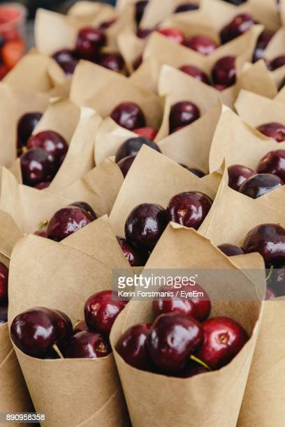 Close-Up Of Red Cherries In Paper Cone