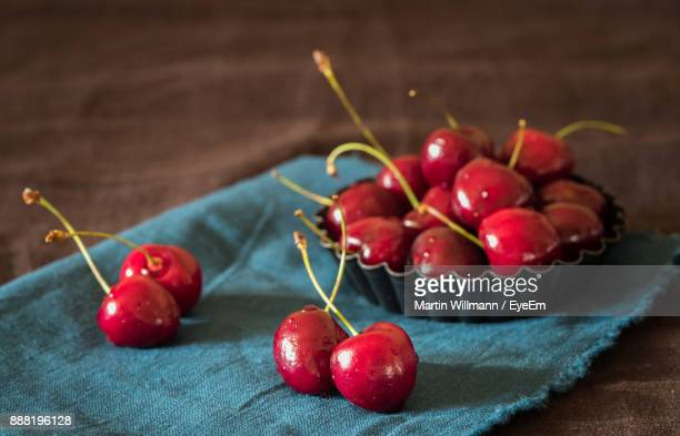 Close-Up Of Red Cherry Fruits On Table