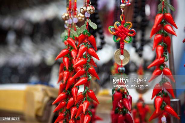 Close-Up Of Red Chili Key Ring Charms Hanging At Market Stall
