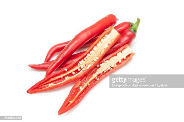 close-up of red chili pepper against white background - thailand stock pictures, royalty-free photos & images