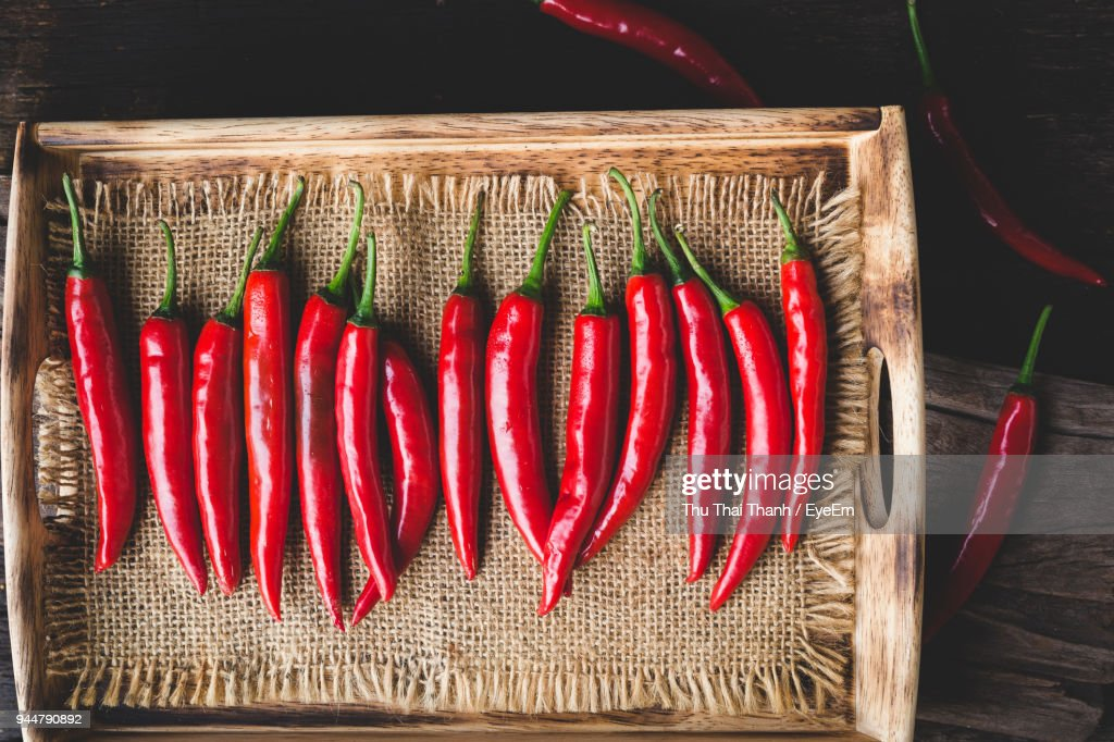 Close-Up Of Red Chili Peppers In Wicker Basket : Stock Photo