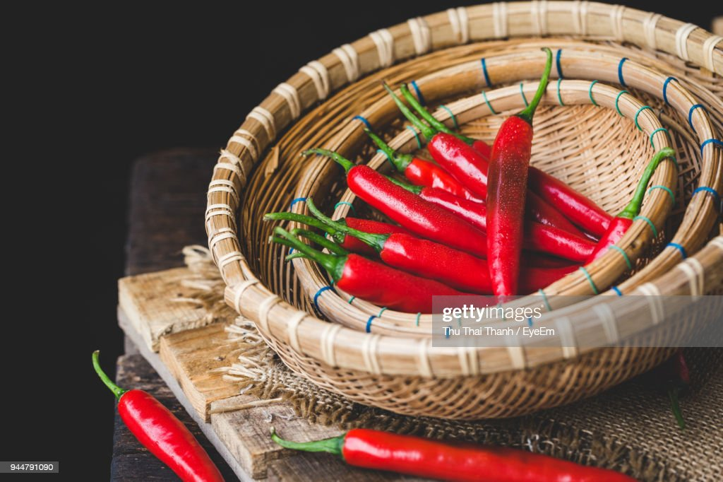 Close-Up Of Red Chili Peppers In Wicker Baskets : Stock Photo