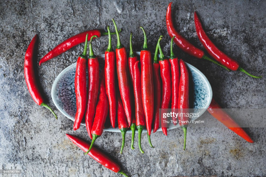 Close-Up Of Red Chili Peppers On Table : Stock Photo