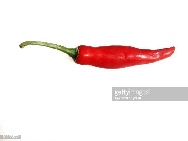 Close-Up Of Red Chili Peppers On White Background