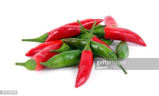 close-up of red chili peppers over white background - scharfe schoten stock-fotos und bilder