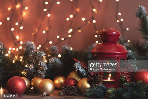 closeup of red christmas balls and fir branch on white background. - christmas banner stock photos and pictures