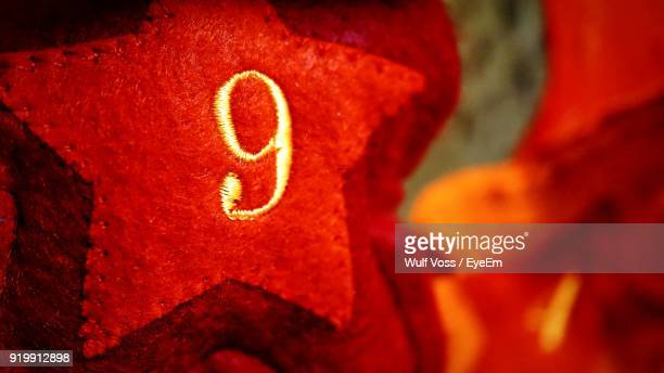 close-up of red christmas decoration with number 9 - 16:9 ストックフォトと画像