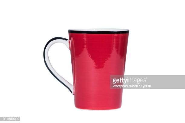 Close-Up Of Red Cup Against White Background