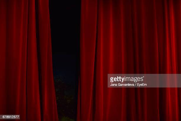 close-up of red curtain - curtain stock pictures, royalty-free photos & images