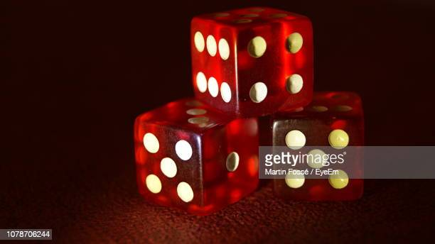 close-up of red dice - three objects stock pictures, royalty-free photos & images