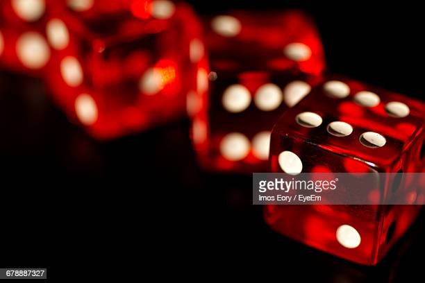Close-up Of Red Dices On Black Background