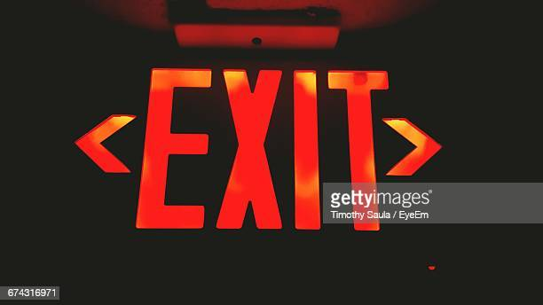 close-up of red exit sign - exit sign stock pictures, royalty-free photos & images