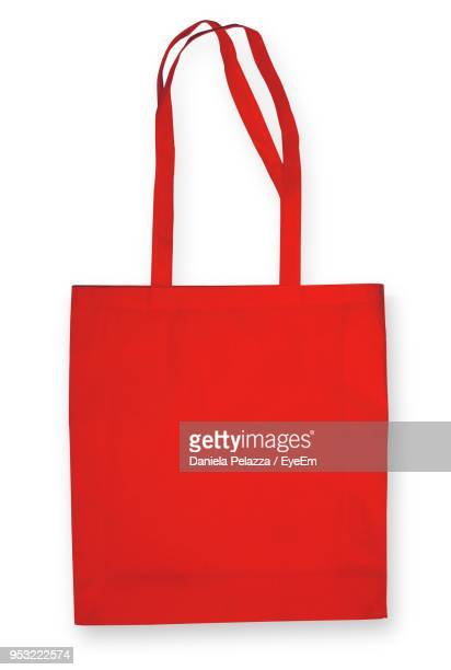 Close-Up Of Red Fabric Bag On White Background