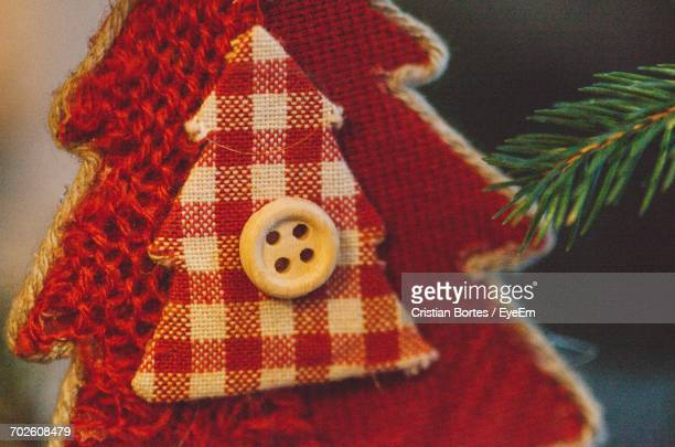 close-up of red fabric decor on christmas tree - bortes stock photos and pictures