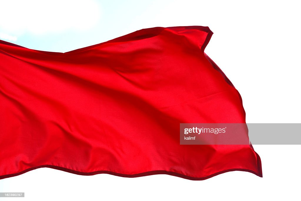 Close-up of red flag waving on white background : Stock Photo