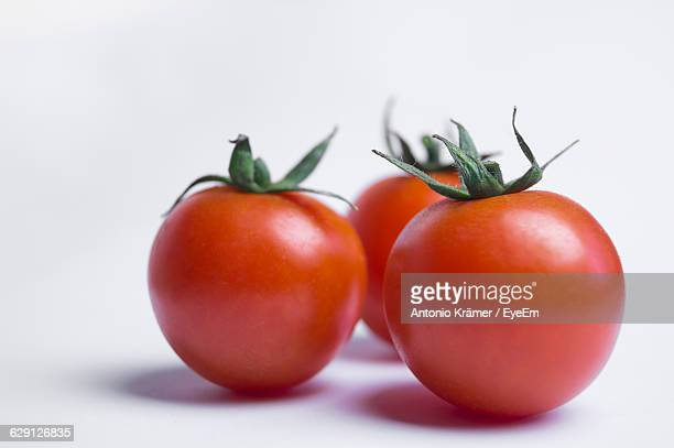 Close-Up Of Red Fresh Tomatoes Against White Background